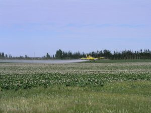 lawn care chemicals Applied to Lawn by Crop Duster