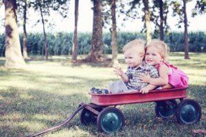 Children in Wagon on Healthy Lawn